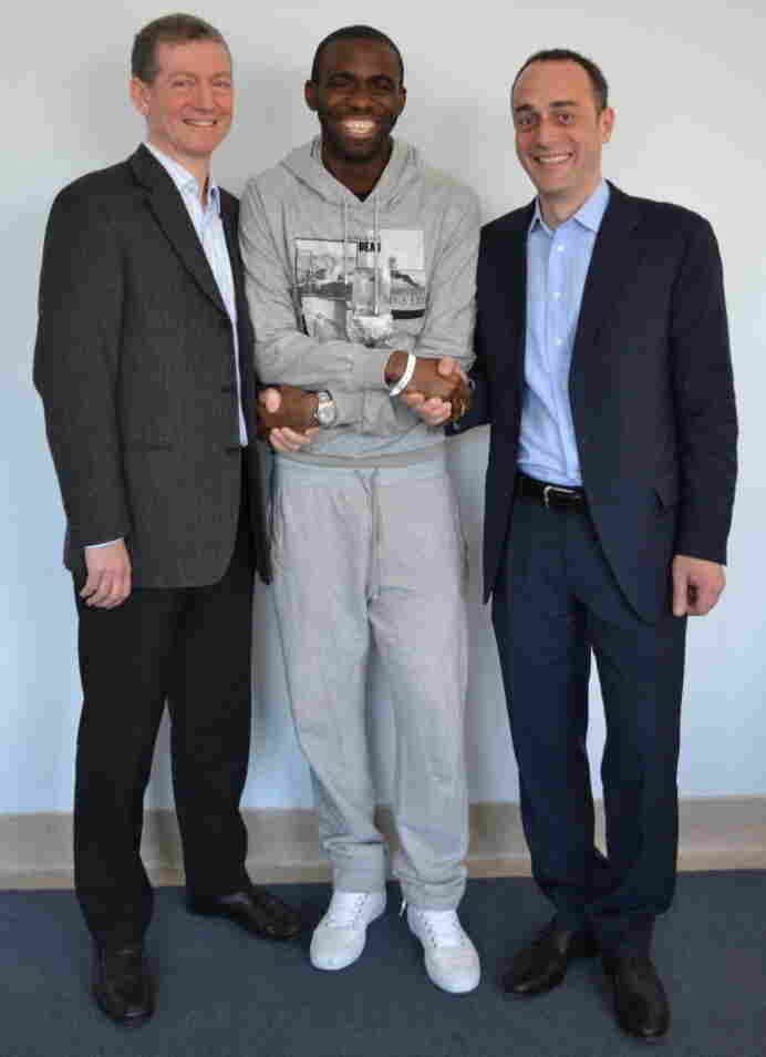 Fabrice Muamba, center, with cardiologist Dr. Andrew Deaner (left) and cardiologist Dr. Sam Mohiddin (right), before his release from the London Chest Hospital today.