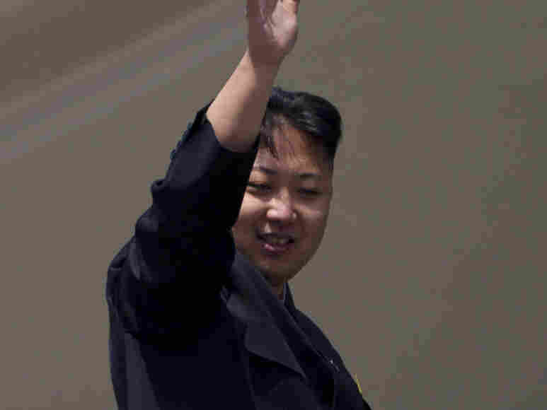 North Korean leader Kim Jong-un waves from a balcony at the end of a mass military parade in Pyongyang's Kim Il Sung Square. Sunday, April 15, 2012. AP Photo/David Guttenfelder)