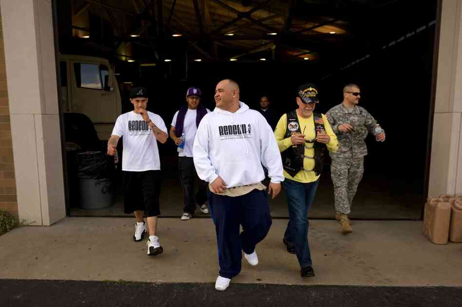 Barillaro (center) leaves the armory after a sound check for his evening hip-hop performance. The 35-year-old comes from a military family; he says he has wanted to be a so