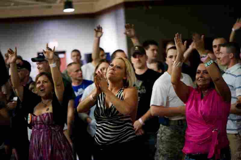 Misty Grayson of Evansville, Ind. (center), claps as Barillaro performs.