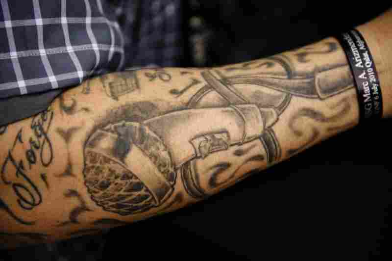 Barillaro's arm is tattooed with a microphone.
