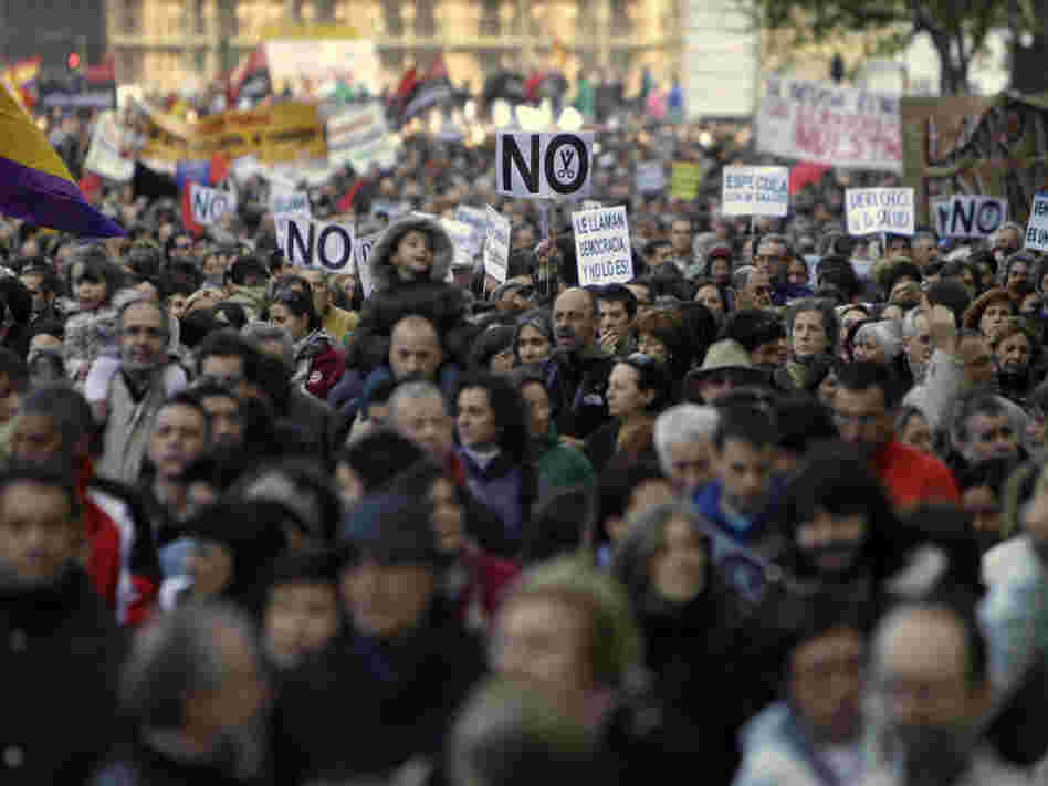 People march during a demonstration against health and education cuts recently announced by the Spanish government, in Madrid on Sunday.