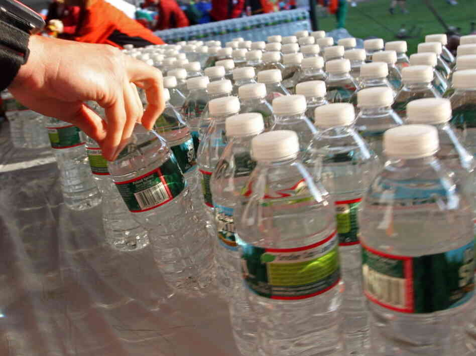 Before the start of the Boston Marathon this morning, a runner grabbed a bottle of water from among the hundreds lined up on a table in Hopkinton, Mass.