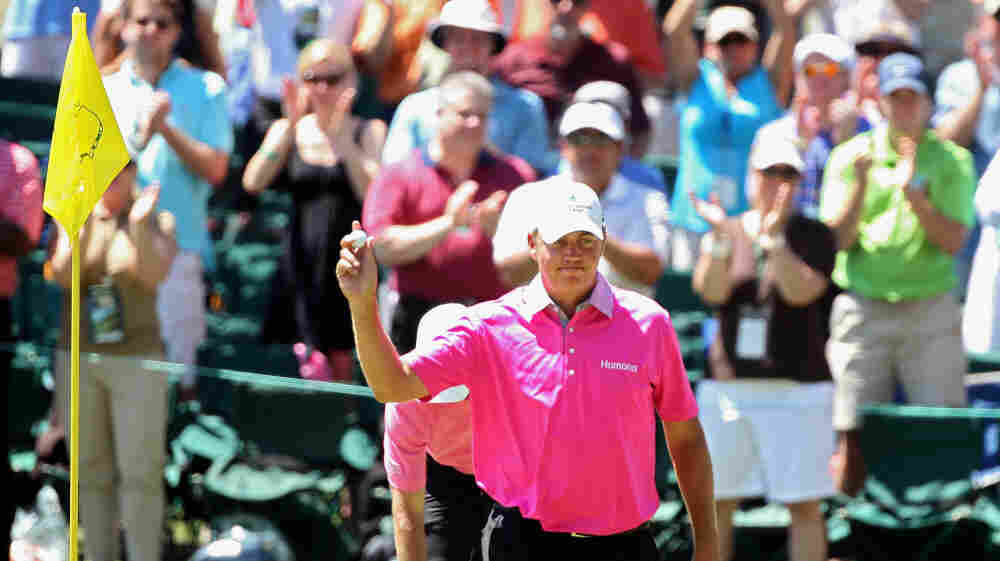 Bo Van Pelt celebrates his hole-in-one during the final round of the Masters on April 8. New research suggests that golfers may be able to improve their games by believing the hole they're aiming for is larger than it really is.