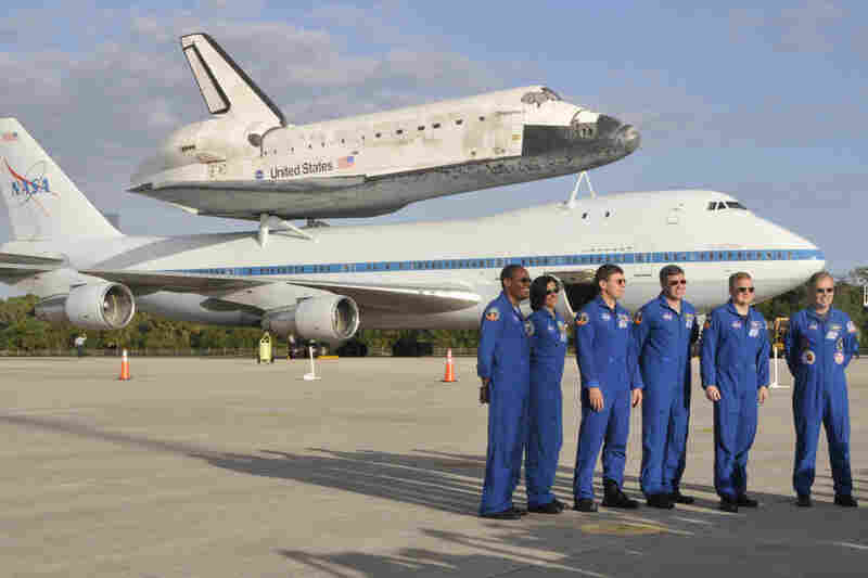 Crew members of the space shuttle Discovery's last mission get one last photo at Cape Canaveral, Fla.