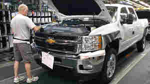 A worker assembles a Silverado truck on the assembly line at the GM Flint Assembly plant in Michigan.