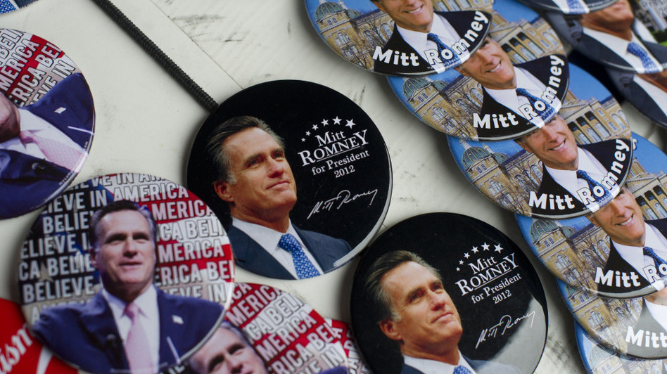 Some voters may be choosing campaign buttons now, but most polling experts agree it's too early to predict November's winner. (Landov)