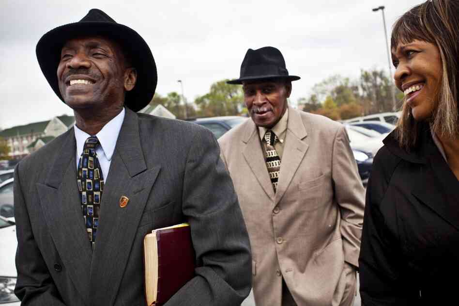 Natasha Shamone-Gilmore walks to church with her husband, Curtis (left), and her father, Franklin Brunson, 81, in Capitol Heights, Md.