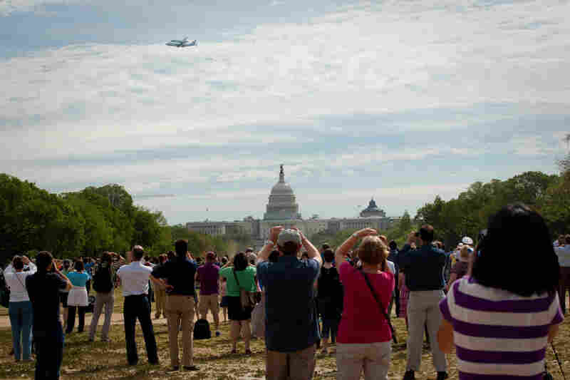 Scores of people took time out of their day to watch Discovery fly over the National Mall.