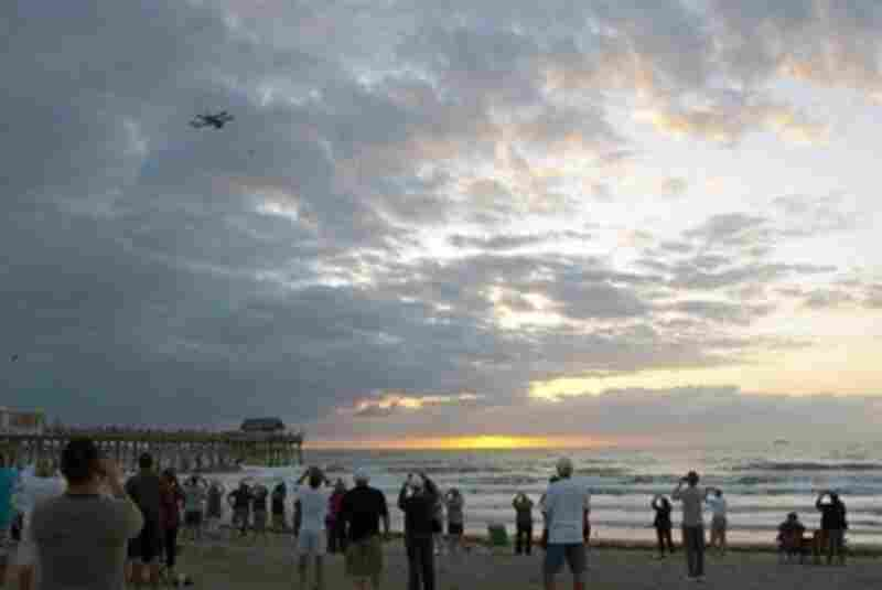 The aircraft transporting Discovery, flies over Cocoa Beach, giving residents the chance to see it for the last time before it leaves the Space Coast.
