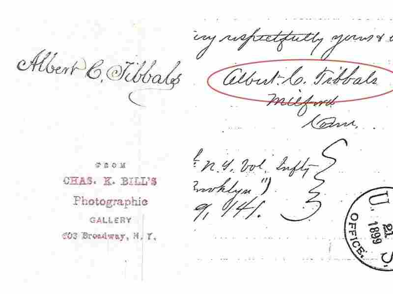 We created this composite image that shows the back of the photo with Tibbals' name (left) and his signature on a letter (right).