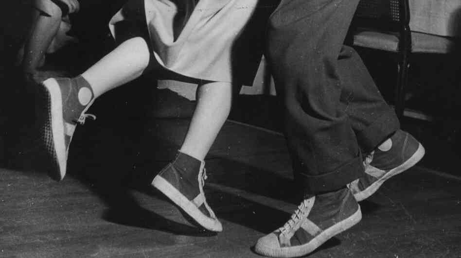 Baseball-booted students jitterbugging at the Carrere night club in Paris. (Photo dated 1949)
