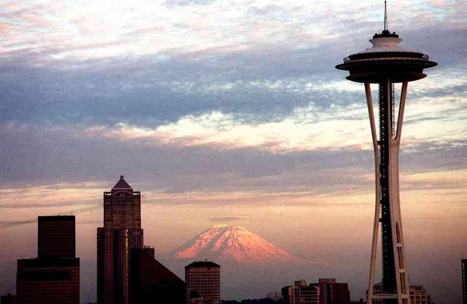 "The Seattle Space Needle's 50th anniversary is Saturday. Though the top of the Needle has been off-white for years, it's being painted its original color, ""galaxy gold,"" for the anniversary."