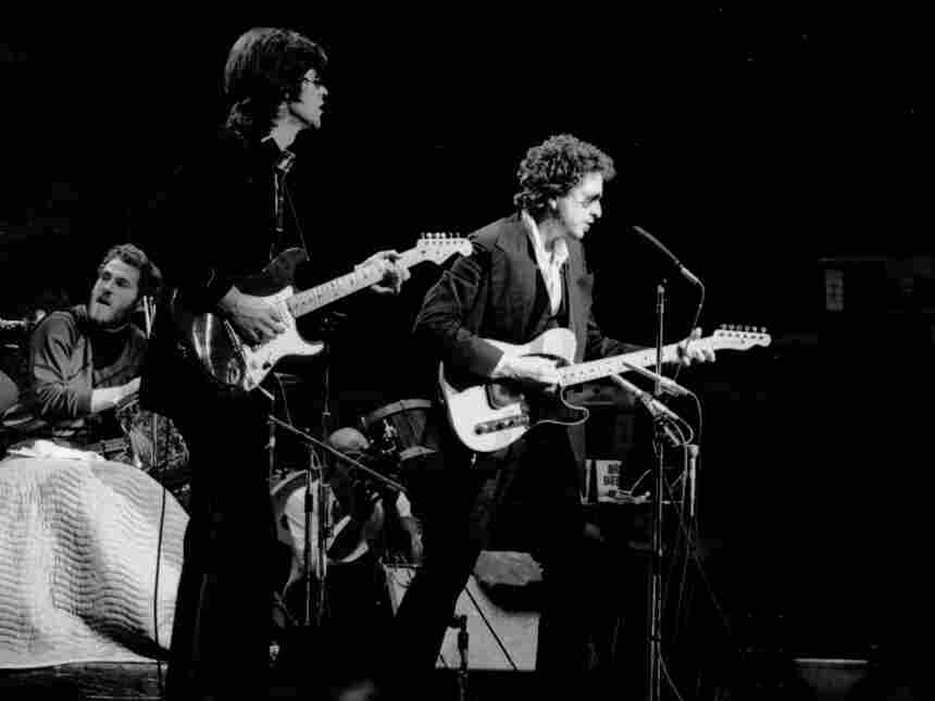 From left to right, Levon Helm, Robbie Robertson and Bob Dylan onstage at Madison Square Garden in 1974.