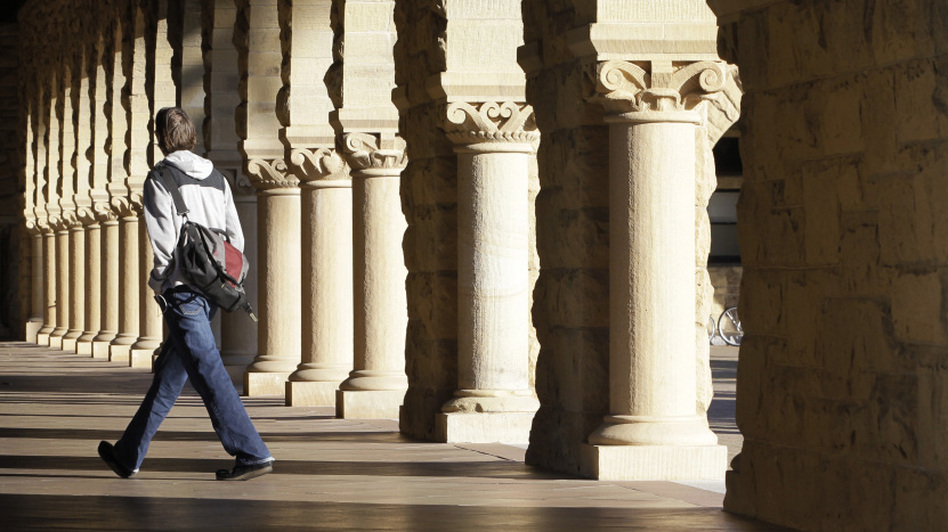 About 7 out of 10 students borrow money to pay for college. Here, a Stanford University student walks through the campus in Palo Alto, Calif. (AP)