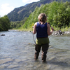 KUOW reporter Ashley Ahearn wades into the Elwha River.