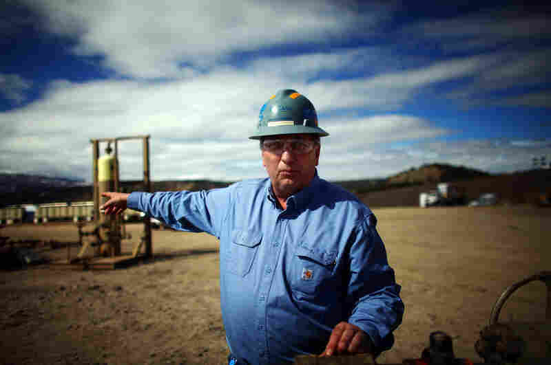 Mark Balderston, an engineer with Encana, a natural gas producer, points to a well pad completion site near Rifle, Colo.