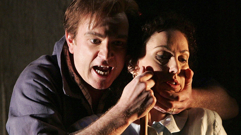 Soprano Cheryl Barker (as Jenůfa) and tenor Peter Wedd (as Luca) sing in a production of Leoš Janáček's Jenůfa from Opera Australia. (Getty Images)