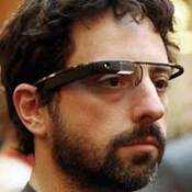 In this photo taken Thursday April 5, 2012 and provided by the Foundation Fighting Blindness, Google co-founder Sergey Brin wears Google's Project Glass prototype publicly for the first time while attending the