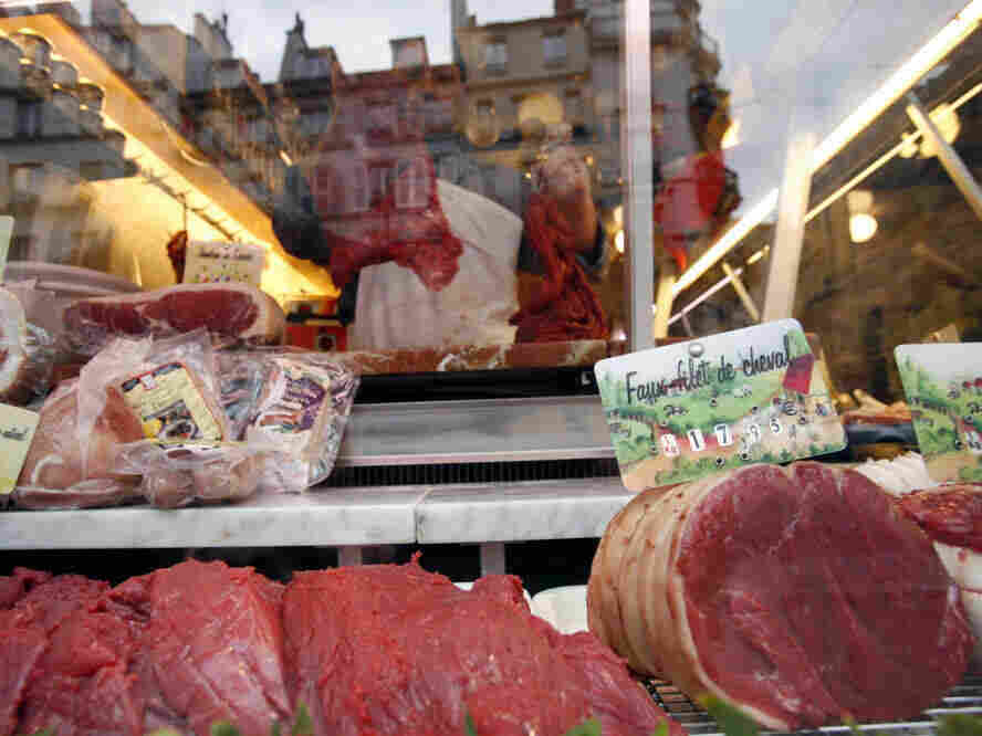 No, that's not beef — it's horse meat, at a butcher shop in France. Horse remains a popular food in many cou