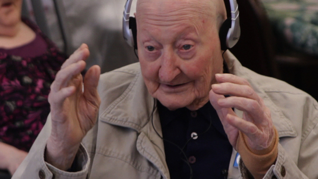Joe, a nursing home resident, broke into song during a personalized music session. His story and others are documented in the film Alive Inside.