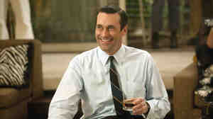 Actor Jon Hamm in a scene from AMC's Mad Men. The show is set in the 1960s — but today, many companies provide their employees with ready access to alcohol.