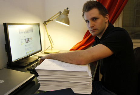 Many Web users have little idea about how, or when, they're being tracked. In this 2011 photo, Max Schrems of Austria sits with 1,222 pages about his activities on Facebook — the company gave him the file after he requested it under European law.
