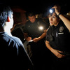 Tucson, Ariz., police officers work in the city's predominantly Hispanic South Side in May 2010. Since April 2010, when Arizona's controversial immigration bill passed into law, crime in the state has hit a 30-year low. Some attribute this to the law, but others are not so sure there's a connection.