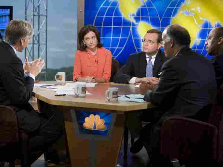 Anne Kornblut of the Washington Post (center) joins media colleagu