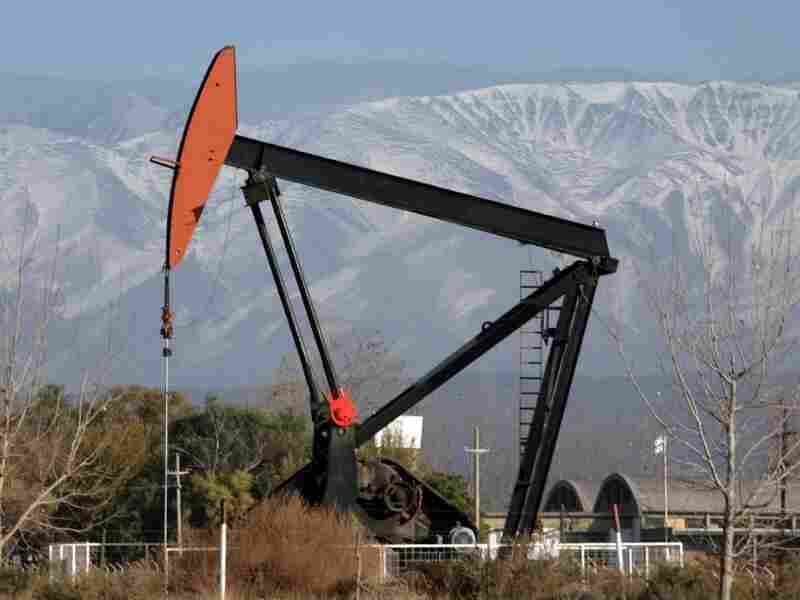 A pump extracts crude oil in western Argentina, at the foot of the Andes mountain range near the border with Chile, in 2007. The refinery is owned by the Spanish company Repsol, but Argentina's government plans to take over the company, which is complaining about the move.