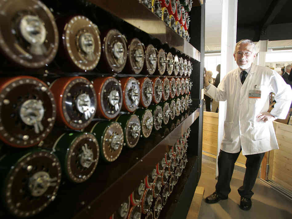 Mike Hillyard, a volunteer who helped build a replica of the Turing Bombe machine, stands beside the machine at Bletchley Park in Milton Keynes, England, in 2009.