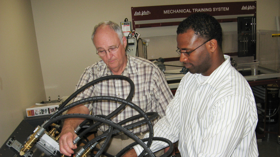 George King (left) with student Marvin Harris in a training lab at a Lone Star College campus in The Woodlands, Tex. Harris plans to work in the oil and gas industry upon completing his program.