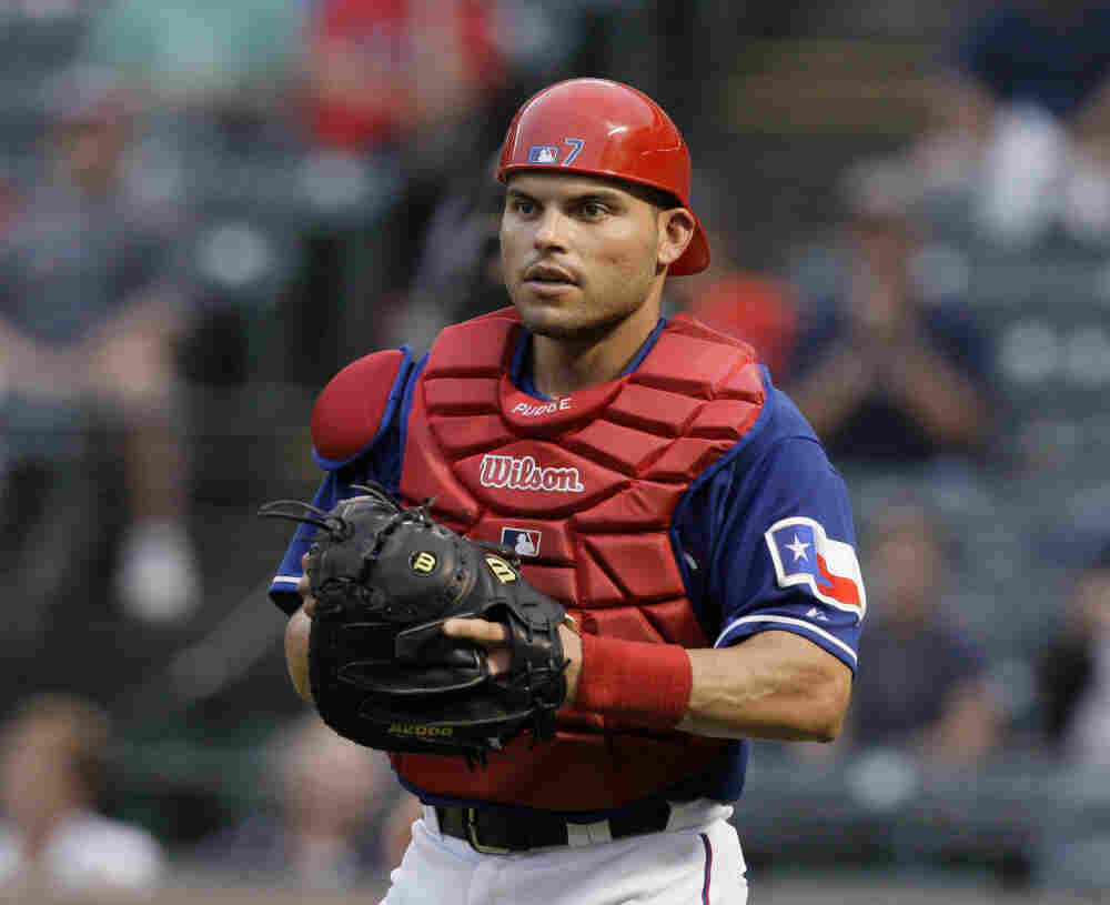In this Sept. 13, 2009, photo, Texas Rangers catcher Ivan Rodriguez pauses during a baseball game against the Seattle Mariners in Arlington, Texas.