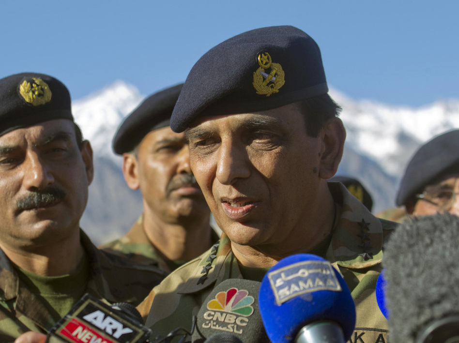 Pakistan's army chief, Gen. Ashfaq Kayani, talks with reporters after visiting the avalanche site on the Siachen glacier Wednesday. Kayani has called for the peaceful resolution of the regional dispute with India. (AP)