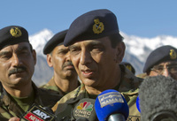Pakistan's army chief, Gen. Ashfaq Kayani, talks with reporters after visiting the avalanche site on the Siachen glacier Wednesday. Kayani has called for the peaceful resolution of the regional dispute with India.