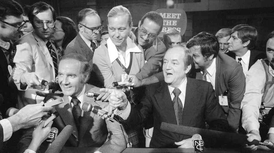 Reporters surround Sens. George McGovern (left) and Hubert Humphrey after a Democratic presidential debate in 1972.