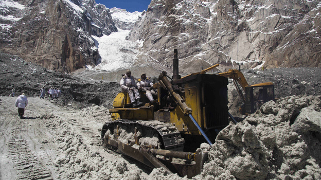 Pakistani army soldiers work Wednesday at the site of a massive avalanche that buried 140 people, including 129 soldiers, April 7 at the Siachen glacier. Pakistan's army chief called for the peaceful resolution of the Himalayan glacier dispute with rival nuclear power India. (AP)