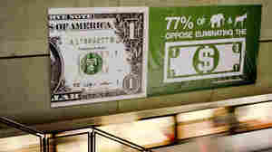 An advertisement for AmericansForGeorge.org is displayed in the Washington, D.C. metro.