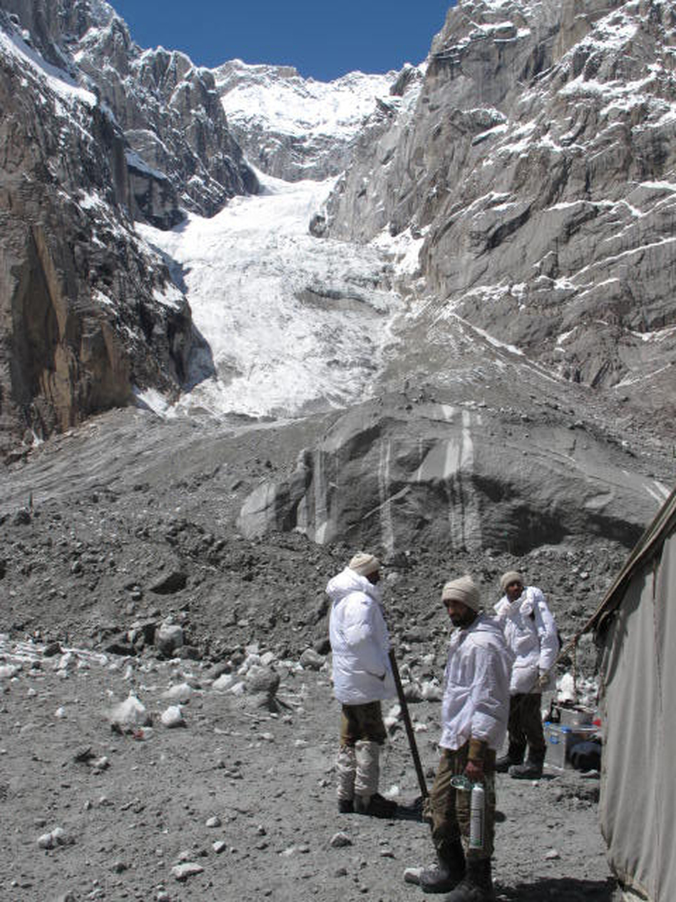 Pakistani army soldiers work Wednesday at the site of a massive avalanche that buried 140 people, including 129 soldiers, April 7 at the Siachen glacier. (NPR)