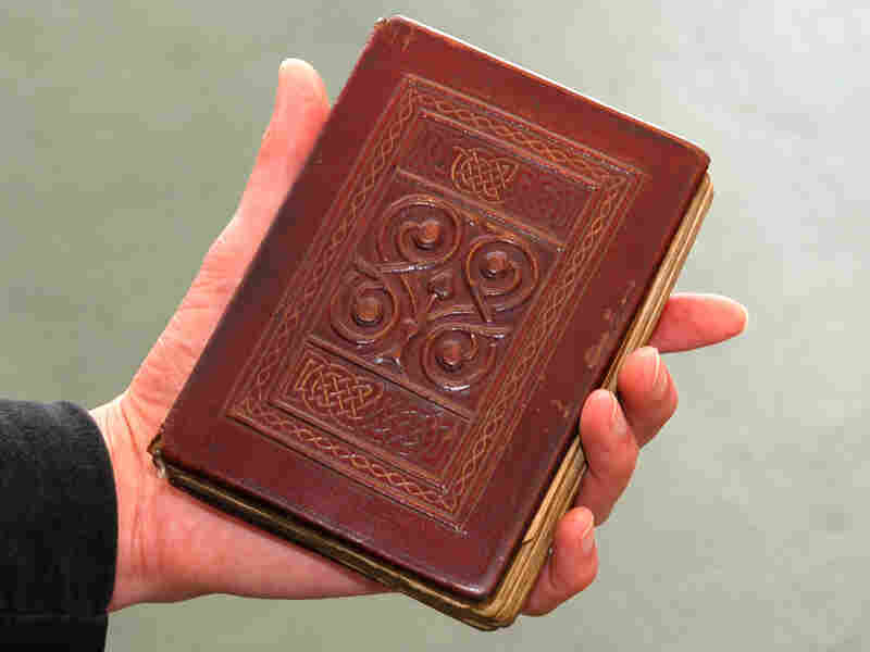 The Gospel, buried with St. Cuthbert in 698, was recovered from his grave in 1104. Its beautiful red leather binding is original.