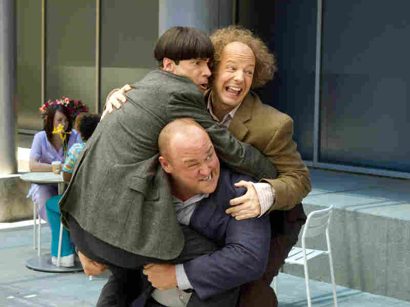 After they leave their orphanage for the first time, Curly (Will Sasso) bears a heavy burden — his fellow Stooges, Moe (Chris Diamantopoulos, left) and Larry (Sean Hayes).