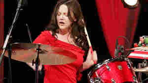 "NEW YORK - DECEMBER 01: Meg White of the White Stripes performs on ""The Daily Show With Jon Stewart,"" the first live band performance for the show, December 1, 2005 in New York City. (Photo by Scott Gries/Getty Images)"