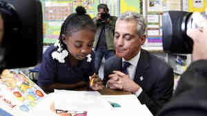 Chicago Mayor Rahm Emanuel sits with South Side first-graders in October. Emanuel's plan to lengthen the school day and the school year has met with resistance.