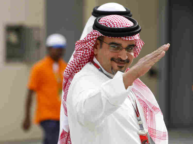 "Bahraini Crown Prince Salman bin Isa Al Khalifa, shown here at a Formula One practice session Friday, says canceling the race would be giving in to ""extremists."""