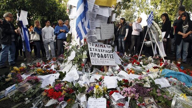 Mourners gather at the spot in front of the Greek parliament in Athens where 77-year-old retired pharmacist Dimitris Christoulas shot and killed himself on April 4. Christoulas left a note saying he did not want to end up scrounging for food in garbage bins. (EPA/Landov)