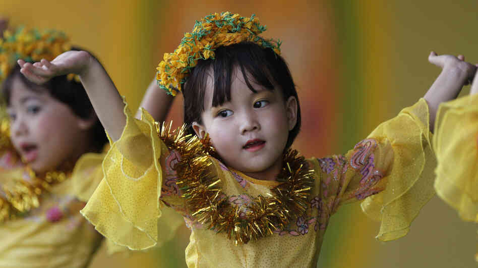 Girls perform a traditional dance while celebrating Thingyan, Myanmar's new year water festival, i
