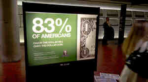 An advertisement by Americans for George is displayed in the Washington, D.C. metro.