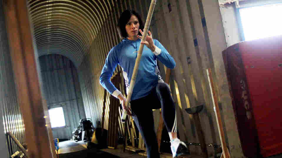 Pole vaulter and Olympic hopeful Jenn Suhr trains in an airplane hangar behind her home outside of Rochester, N.Y.