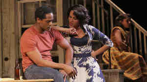Stanley (Blair Underwood) and his sister-in-law, Blanche DuBois (Nicole Ari Parker), spar while Stanley's wife, Stella (Daphne Rubin-Vega), sits outside.