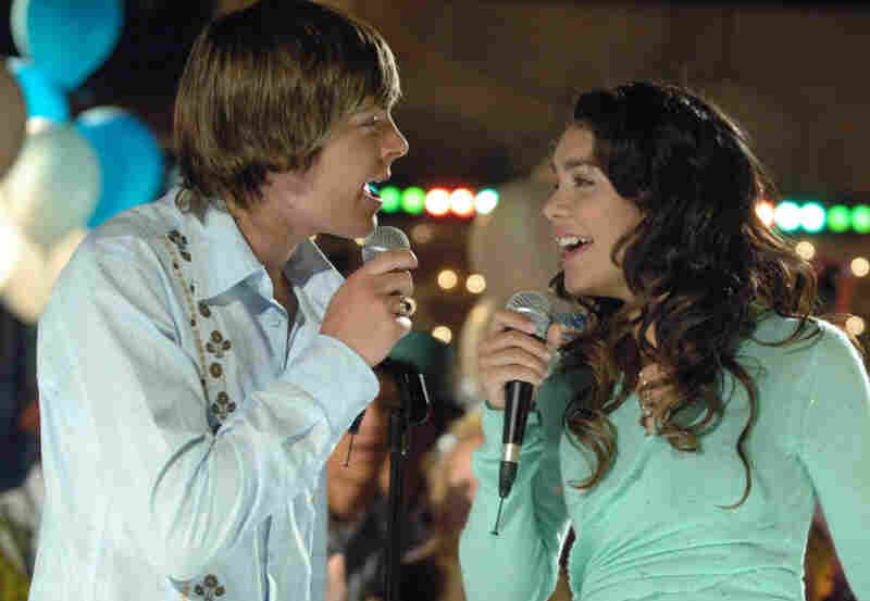 Actors Zac Efron, as basketball star Troy, left, and Vanessa Anne Hudgens, as the shy academic Gabriella, in High School Musical, seen in this undated photo relea